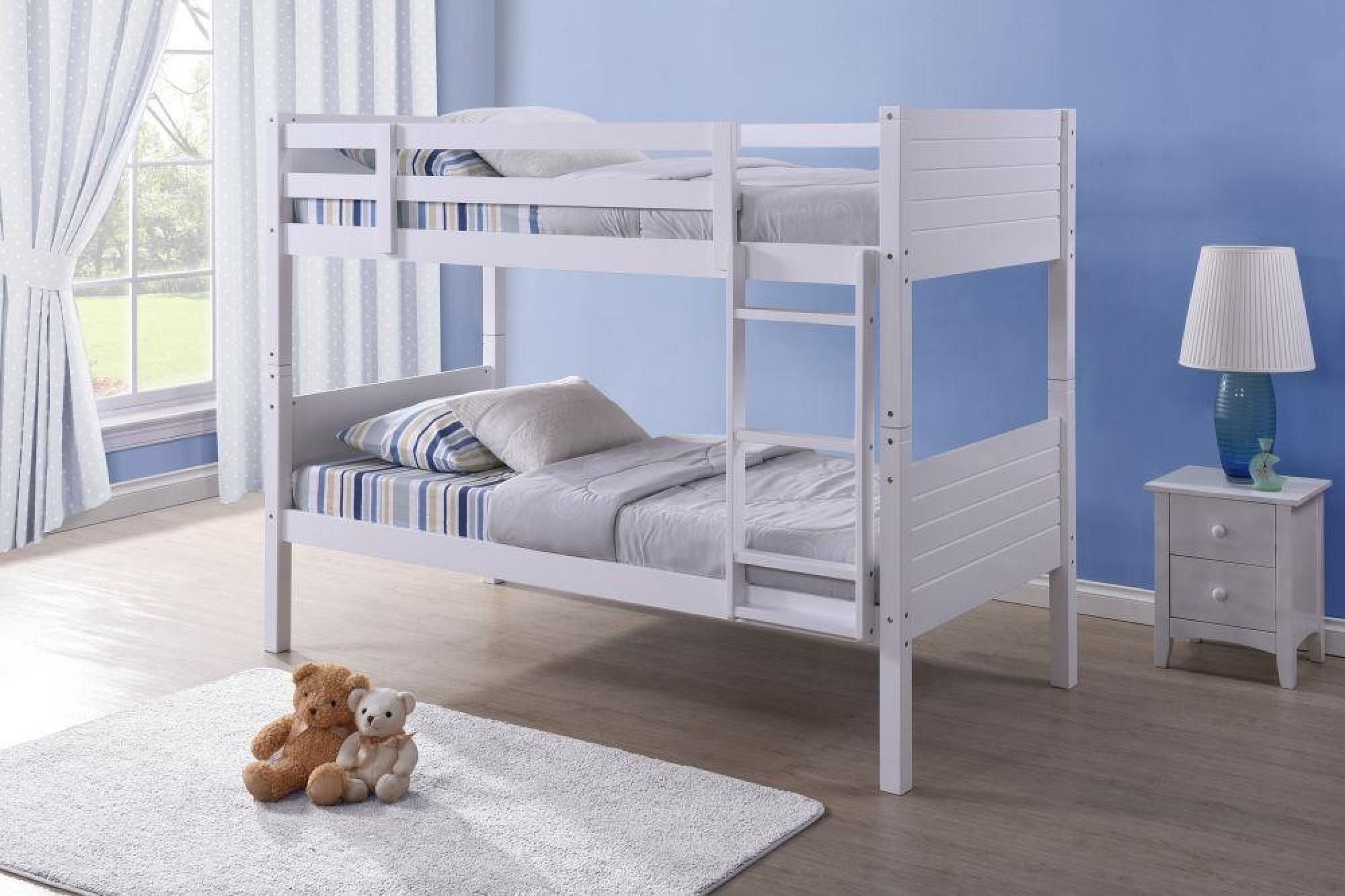 The bunk bed is presented in a beautiful white design in a very traditional style that you and your children will love. The bed comes with an adjustable ladder which makes it easier to climb up to the top of the bed.  The bed is constructed using high quality materials for increased stability and sturdiness and is finished in white. The coating not only gives a great look it also protects the wooden frame. Also, the bunk bed can be split in two single beds if necessary. Actual Dimensions  3ft Measurements: Width: 98.3 cmLength: 201 cmHeight: 153.4 cm