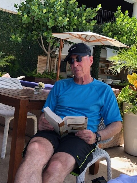 "Reading ""Time Regained"" on Maui."