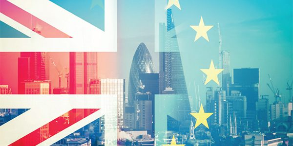 London+skyline+behind+Union+Jack+and+EU+Flag.jpeg