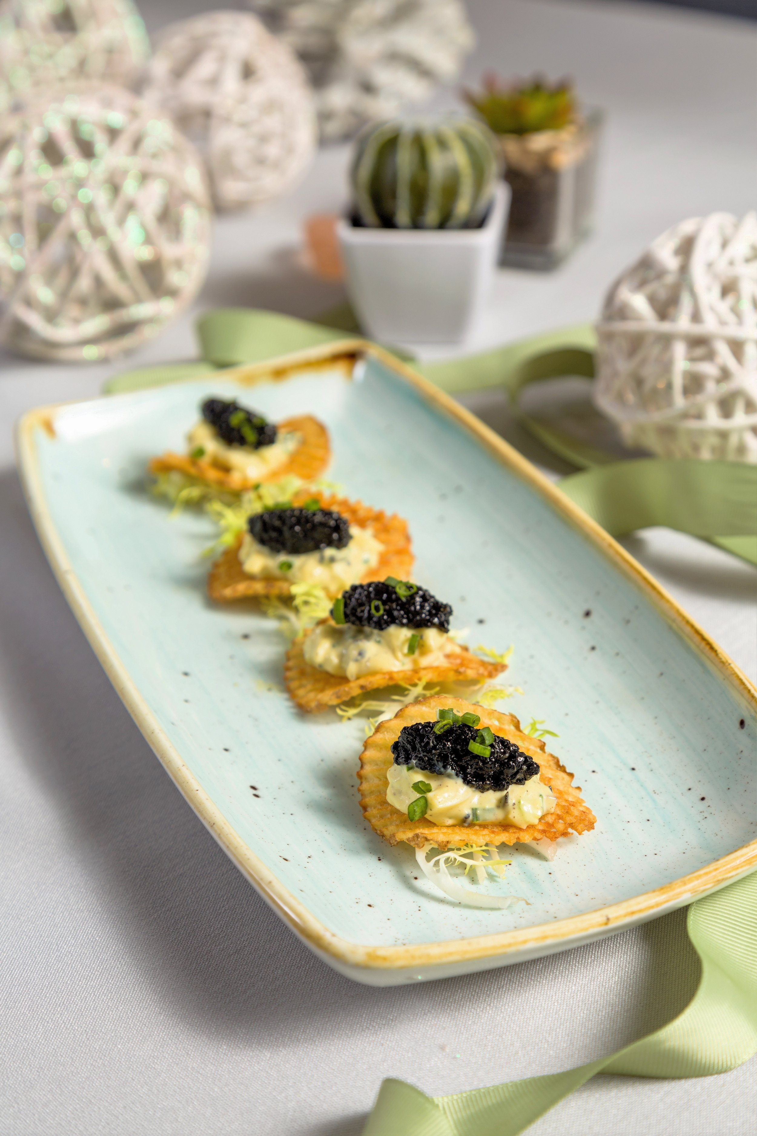 pom puree on gaufrette with caviar.jpg