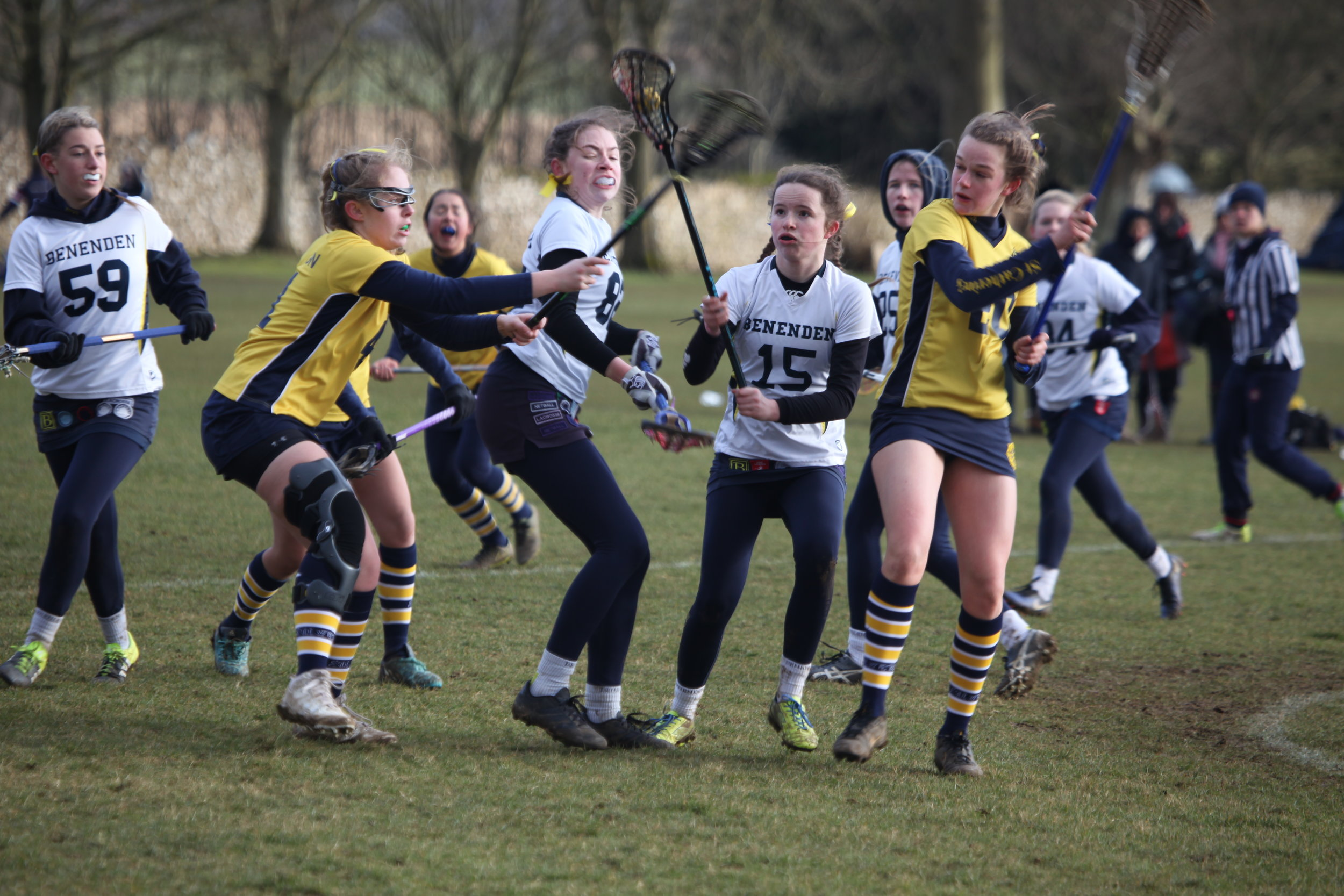 Girls playing lacrosse at school