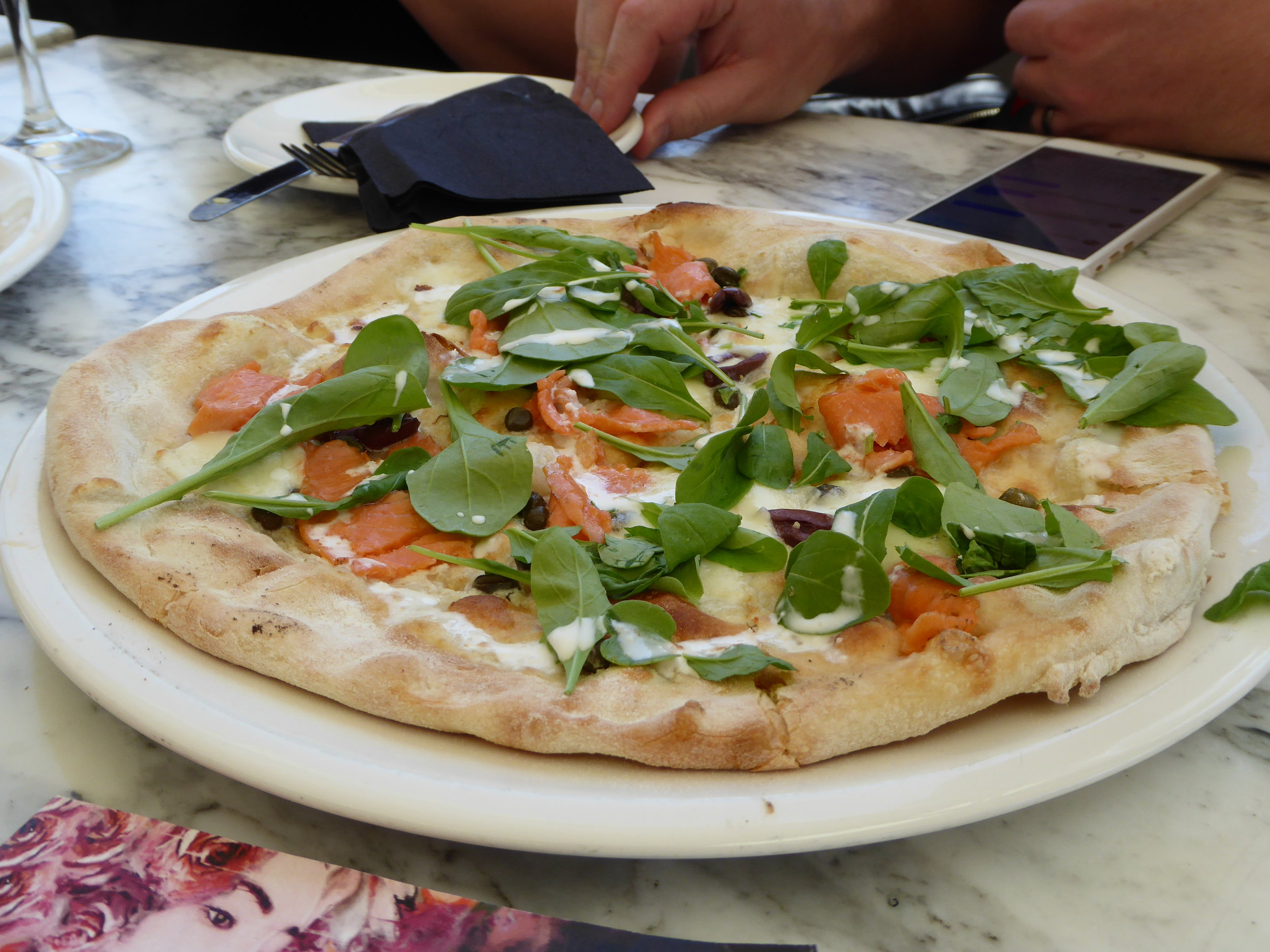 That's salmon pizza, only the fresh ingredients here.