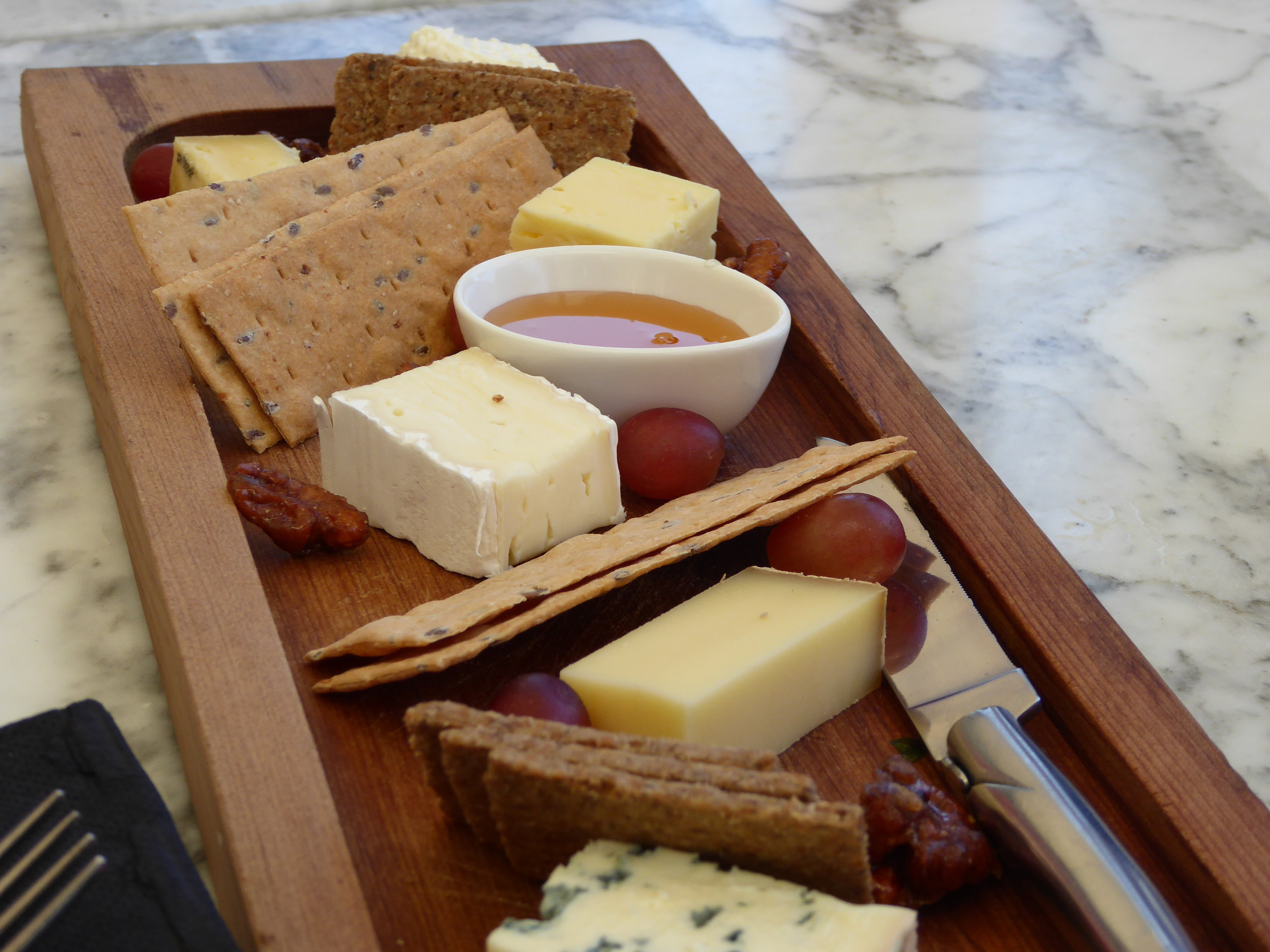 A selection of cheeses with New Zealand's famous Manuka Honey.