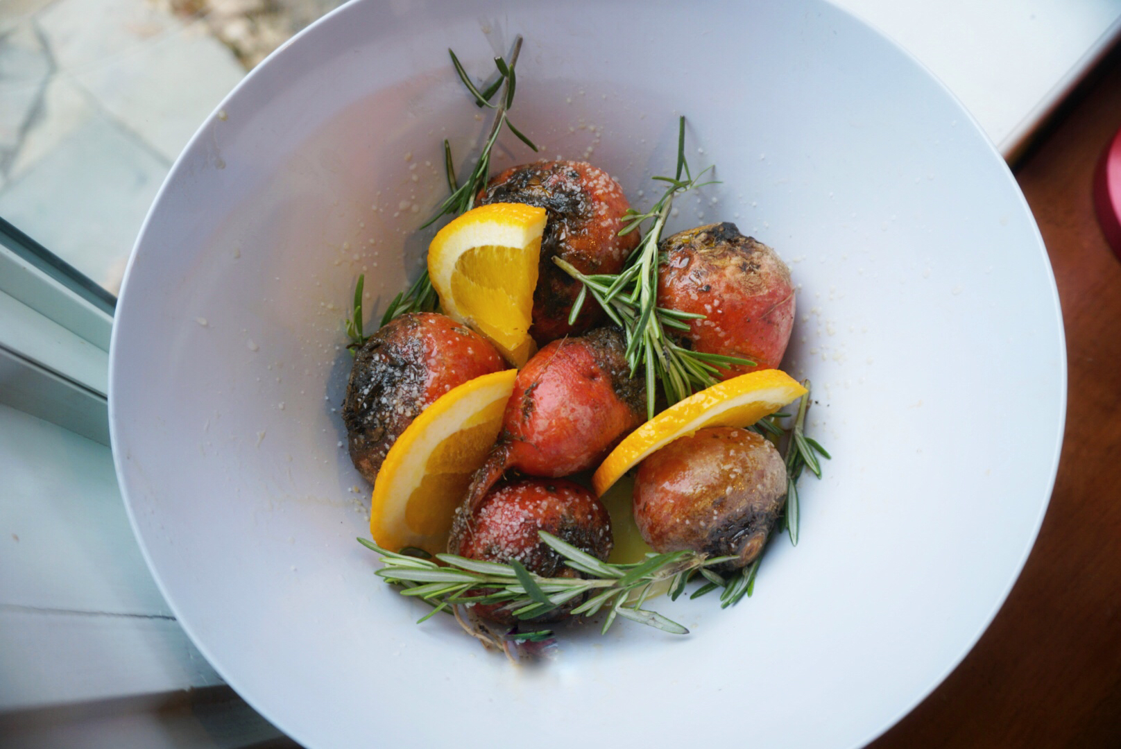 golden beets, oranges, and rosemary - about to get roasted in the coals of a wood fire.