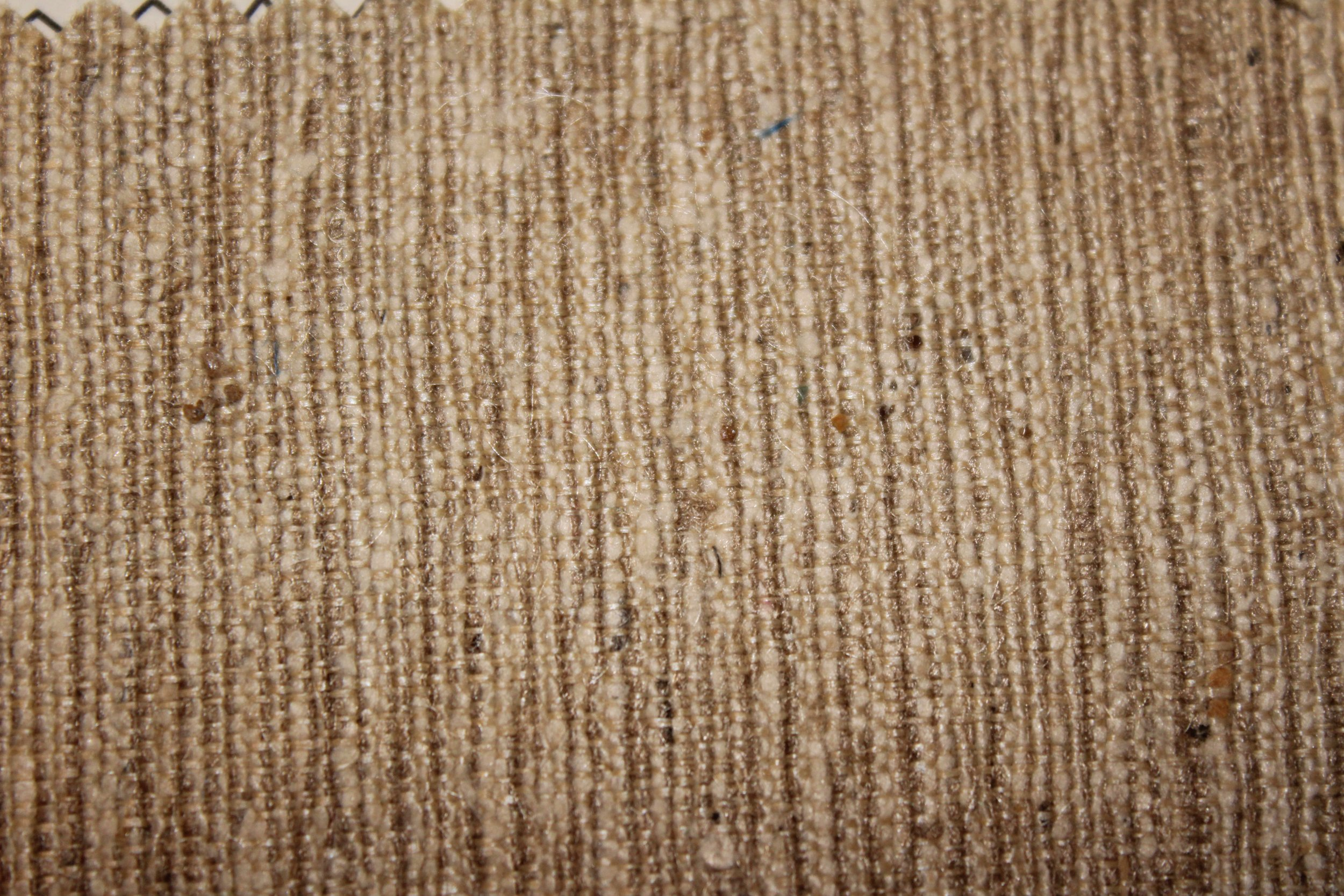 Tussah silk typically has a rougher texture, although not always this rough. The brownish to cream color is also typical of Tussah silk.