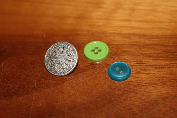 Shank button, four hole button, and two hole button.