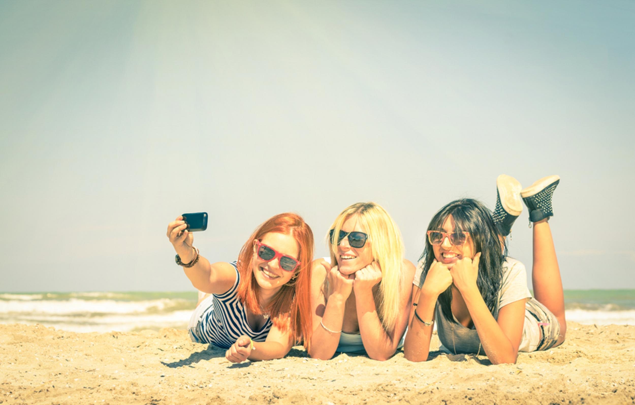 bigstock-Happy-Girlfriends-Taking-A-Sel-94376621.jpg