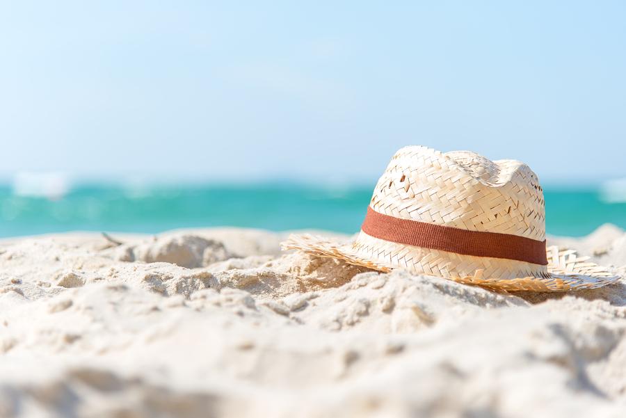 bigstock-Summer-Vacations--Hat-Of-Trav-232285207.jpg