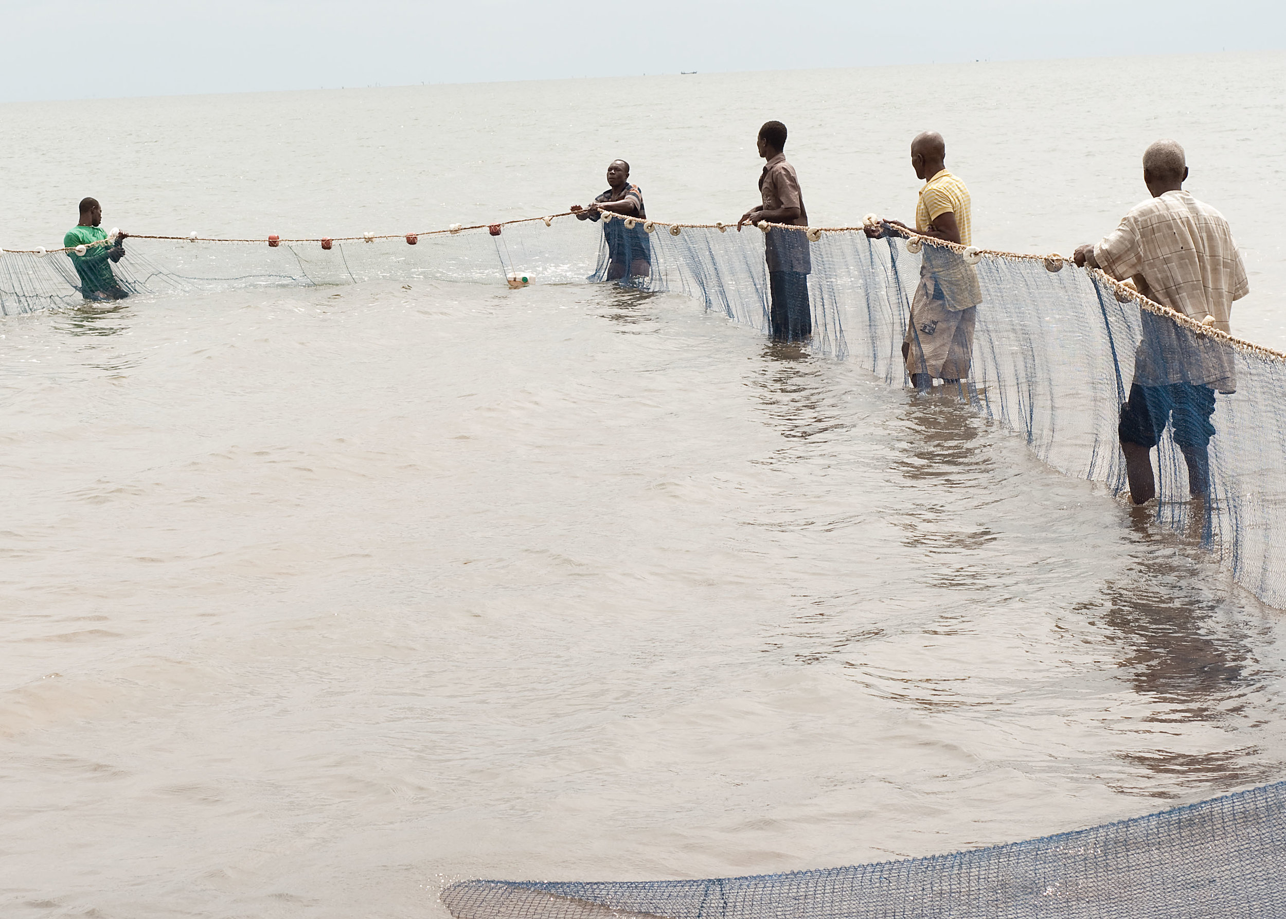 village fishermen pulling in nets