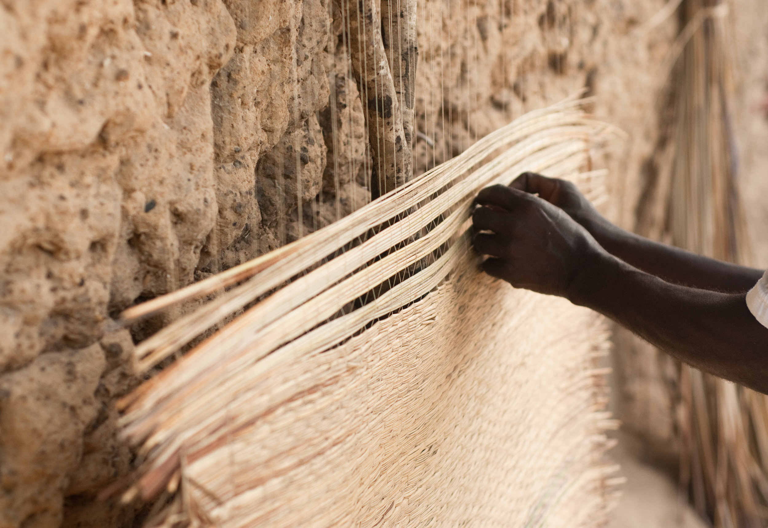 Belinda's father weaving mats