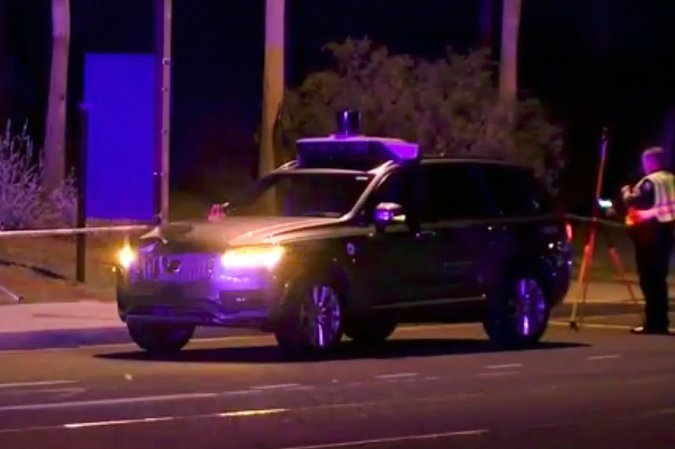 A self-driving Uber car at the scene of a fatal accident in Tempe, Arizona