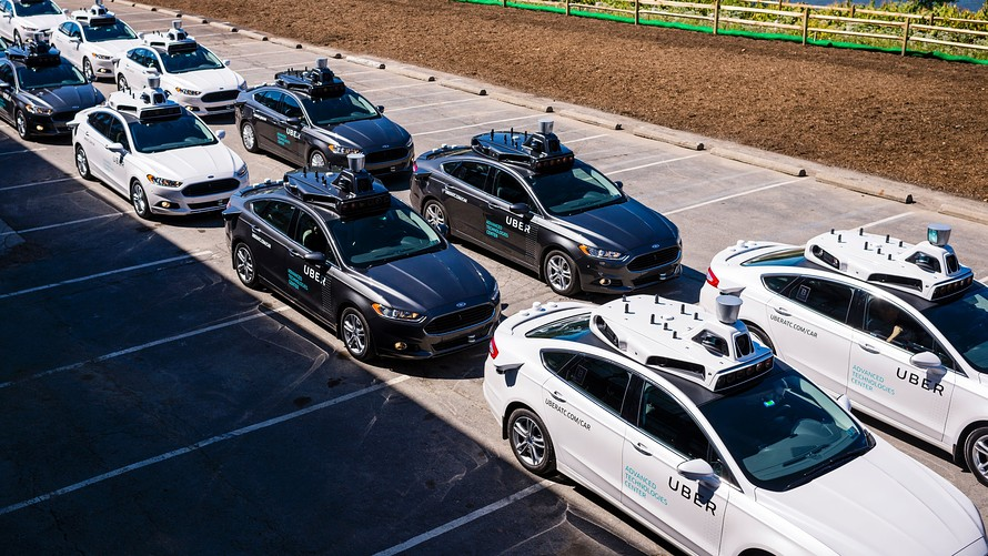 Pilot models of the Uber self-driving car is displayed at the Uber Advanced Technologies Center on Sept. 13, 2016.