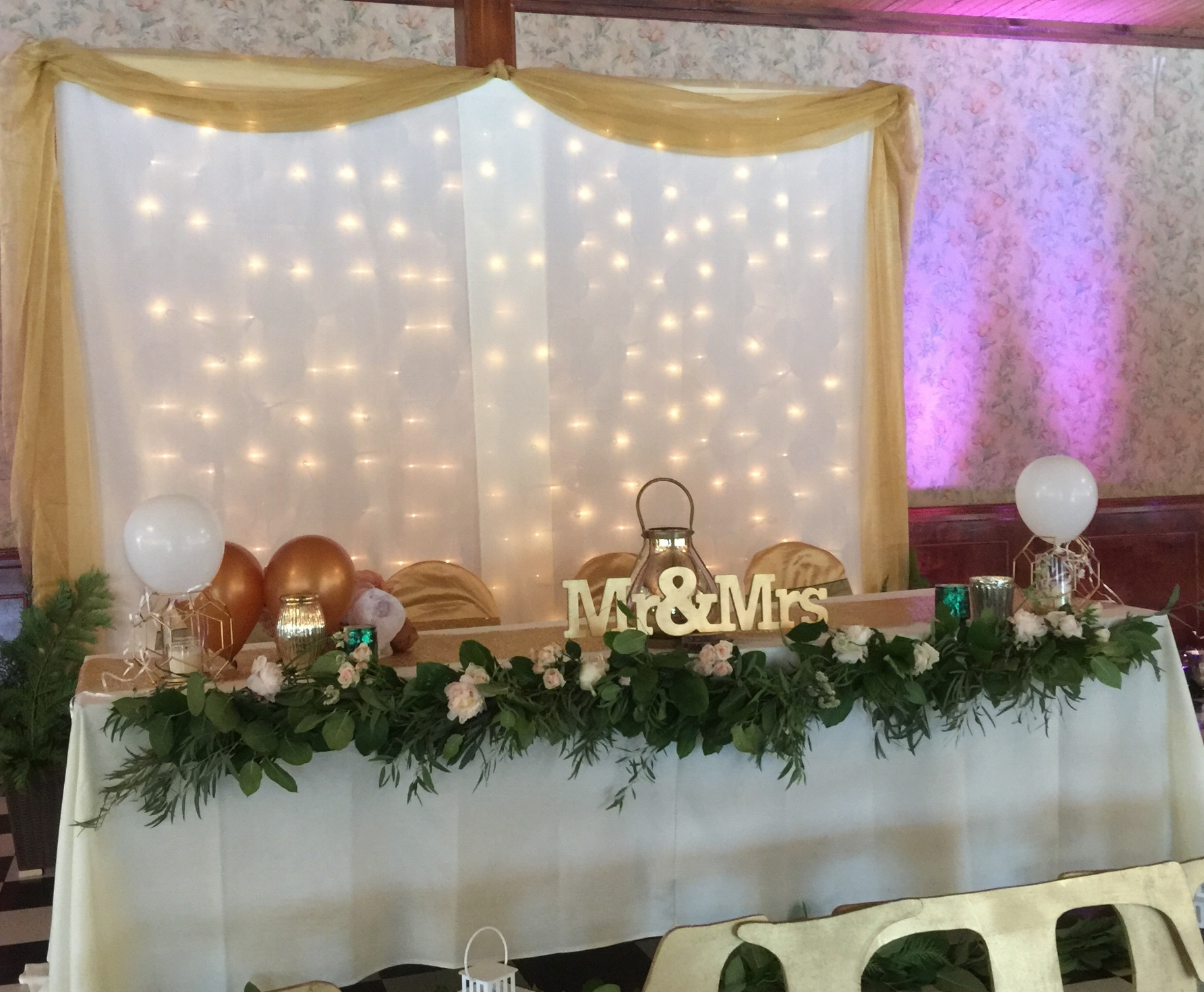 Head table with back drop.jpg