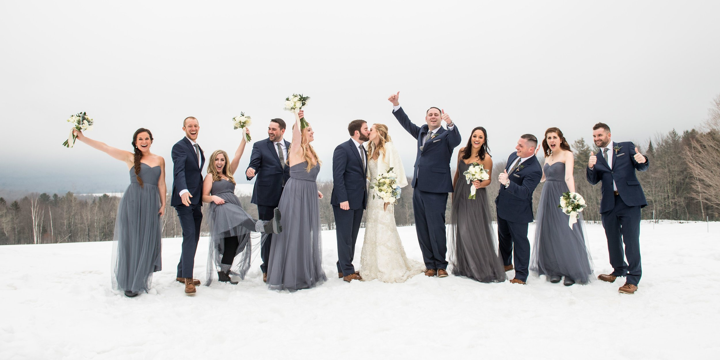 Wedding party fun in the snow as photographed by Steve Holmes.