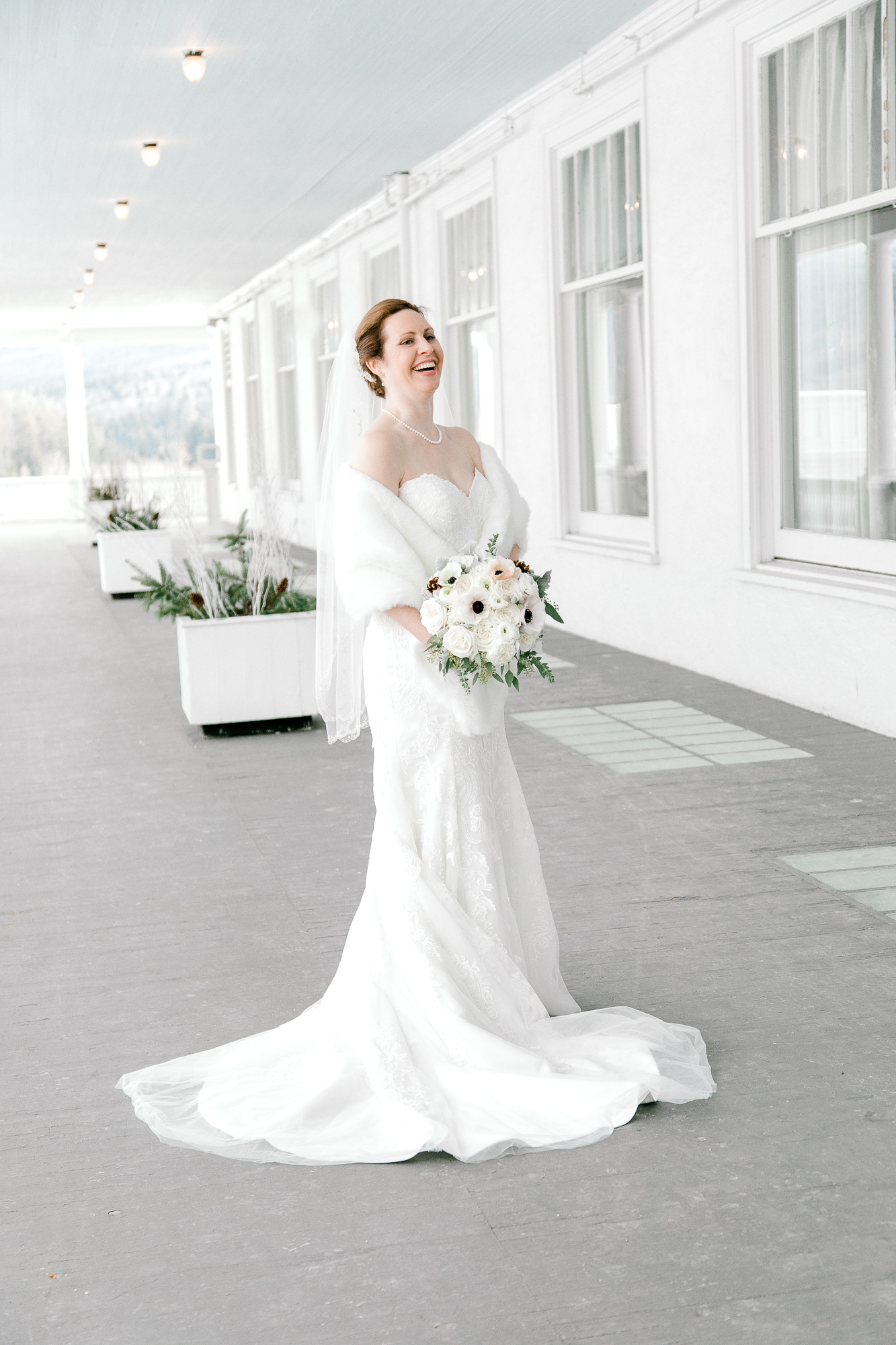 Beautiful Bride with winter bouquet as photographed by Kris Lenox.