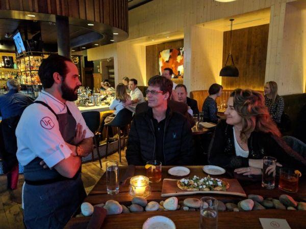 Chef Chris Sarkus talking with Denver food tour guests in Urban Farmer Denver