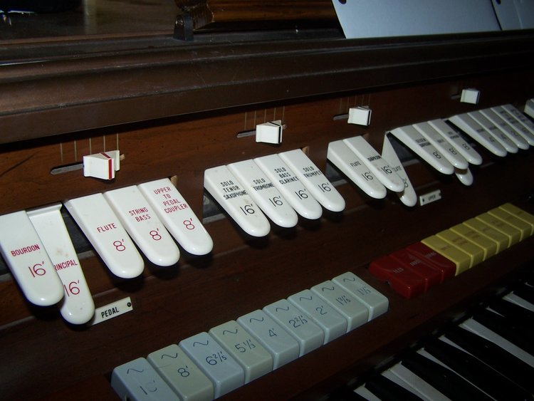 A close-up look at the stops on an electronic organ.