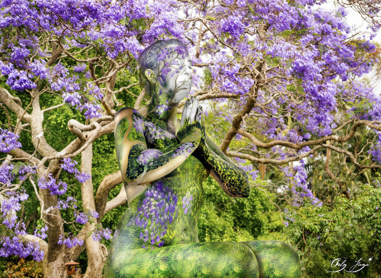 """A meditating woman is """"merged"""" into a flowering tree."""
