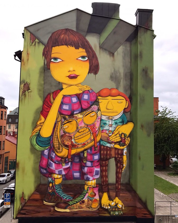 Another OSGEMEOS original, featuring colorful characters. This one's in Stockholm, Sweden.