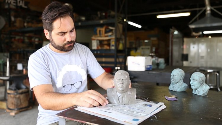 Jim Dessicino observes a bust he's made of New Jersey governor, Chris Christie.