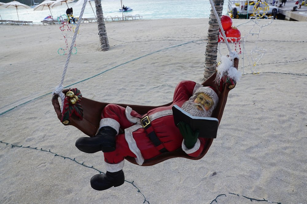 "Santa has this ""light reading"" thing down, but his beach attire still needs some work."