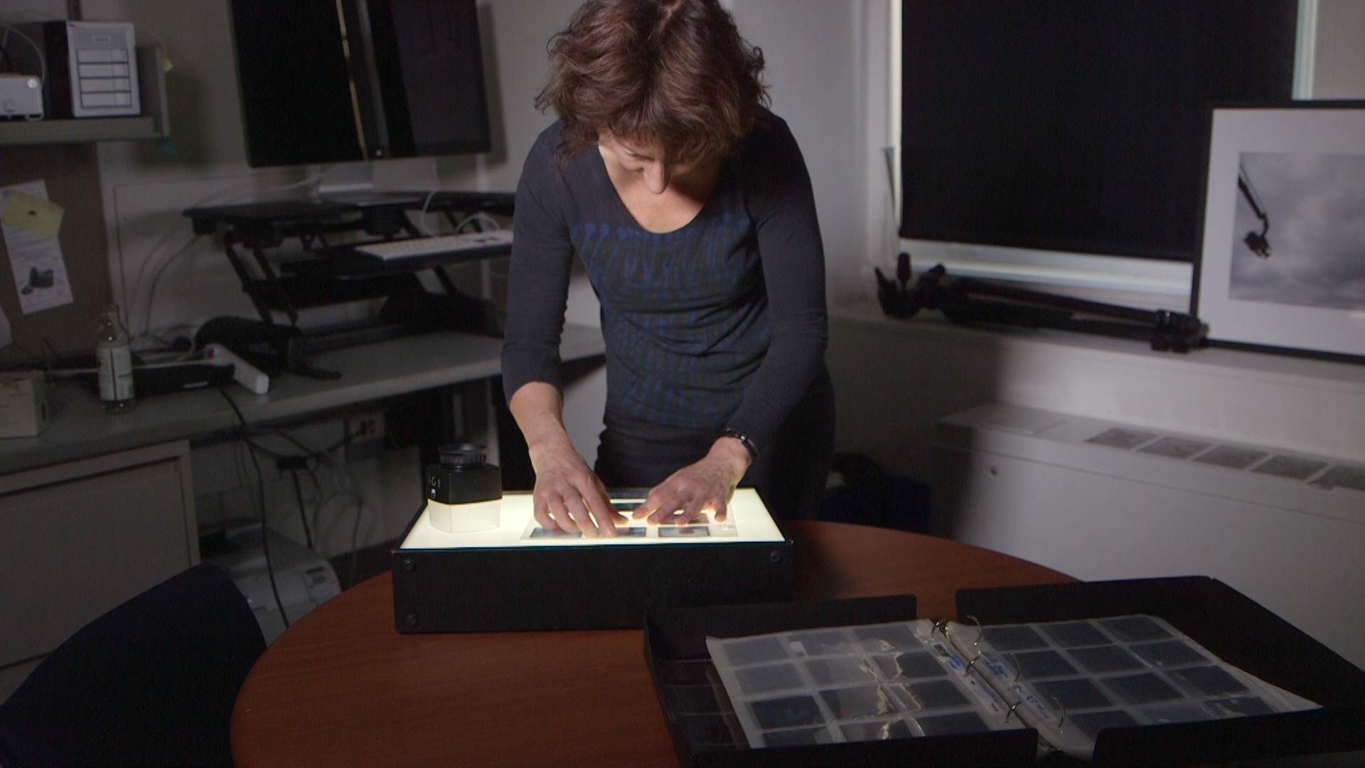 Nina Berman Examining Photographs.jpg