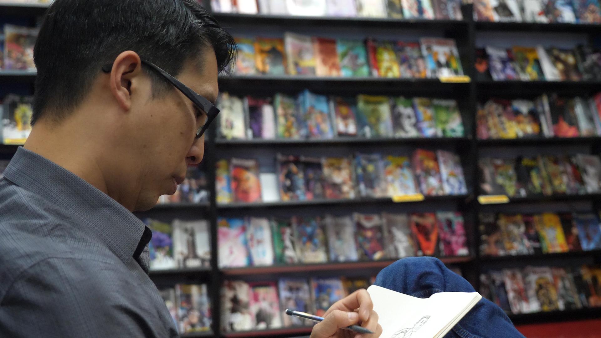 Gene Yang doodling in a comic book store.jpg