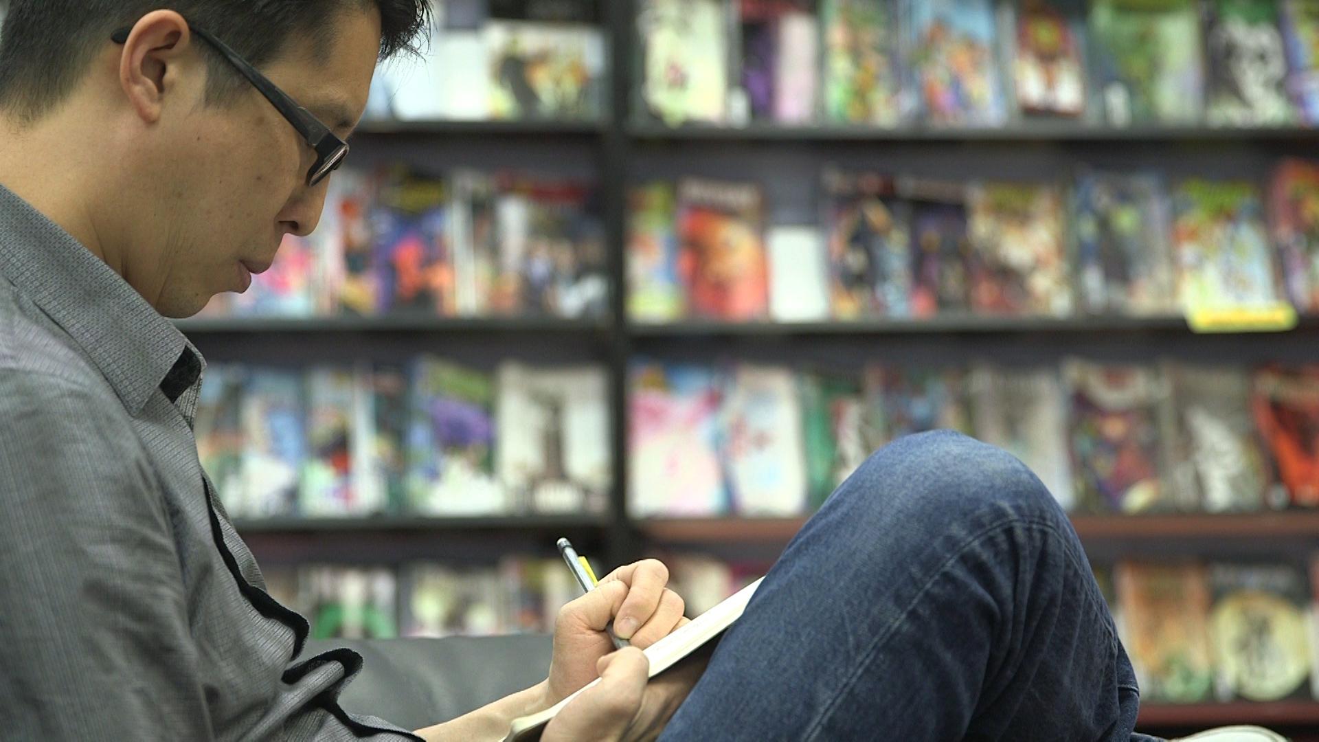 Gene Yang Doing art in comic book store different angle.jpg