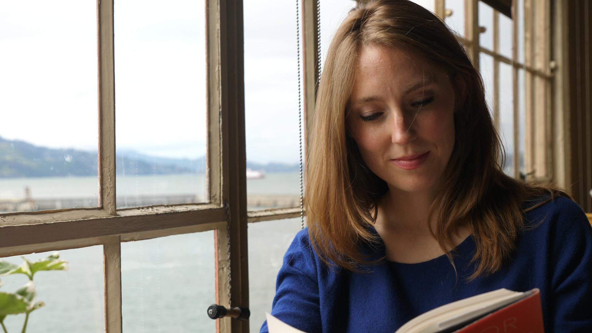 RIP Romance Moira Weigel reading a book.jpg