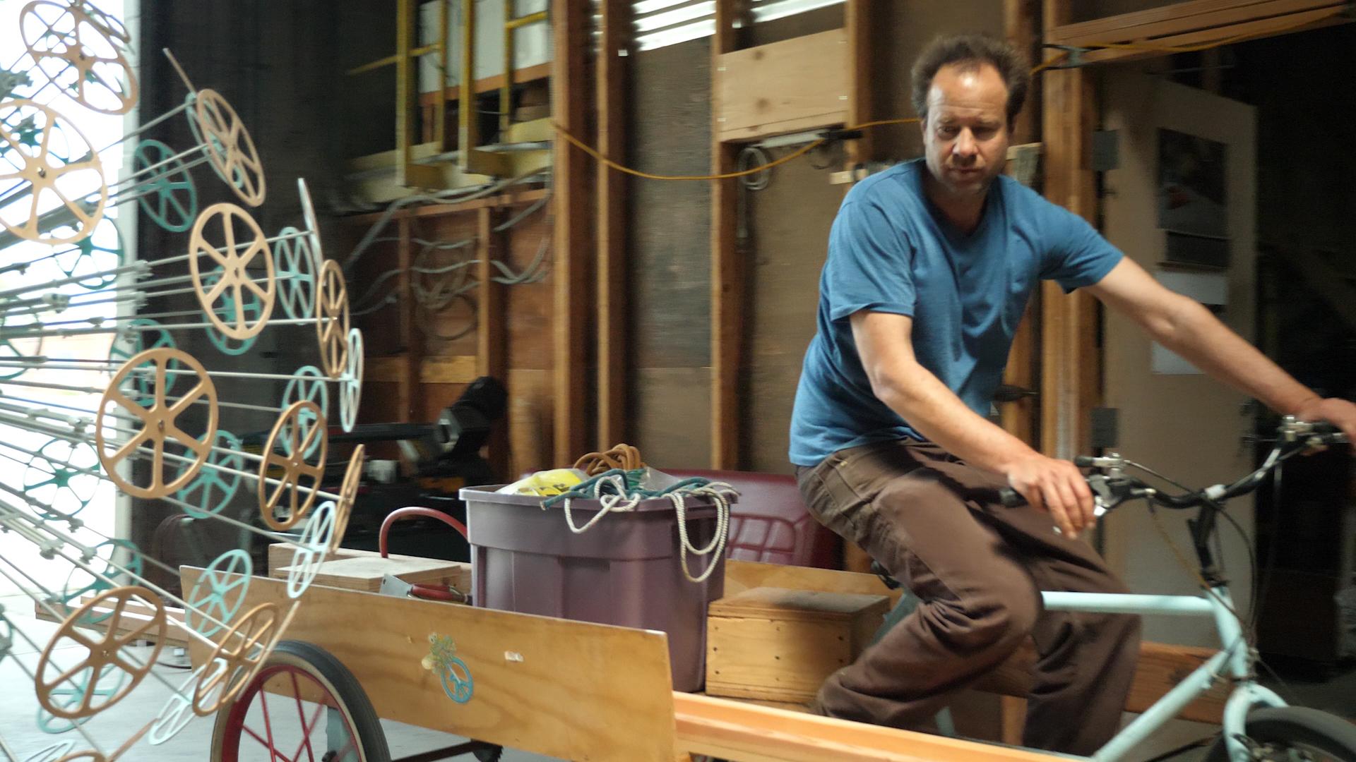 Reuben Margolin riding his bike AND the coolest sculpture ever.jpg