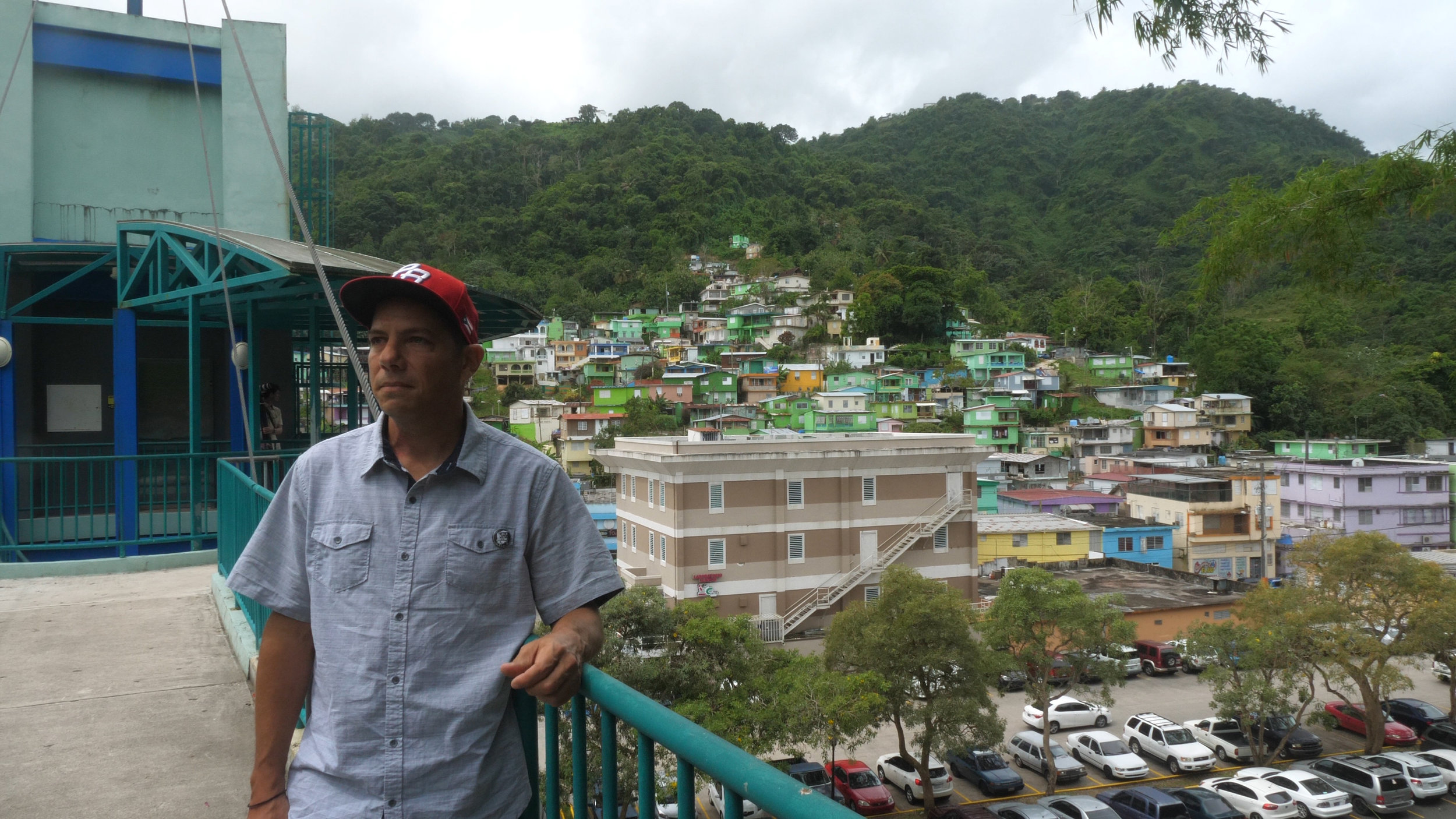 Chemi Rosado with the town he painted green in Costa Rica.jpg