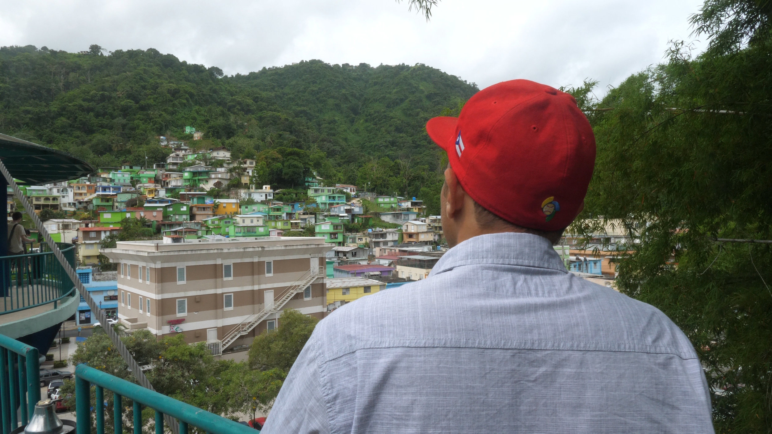 Chemi Rosado looking out over the town he painted in Costa Rica.jpg