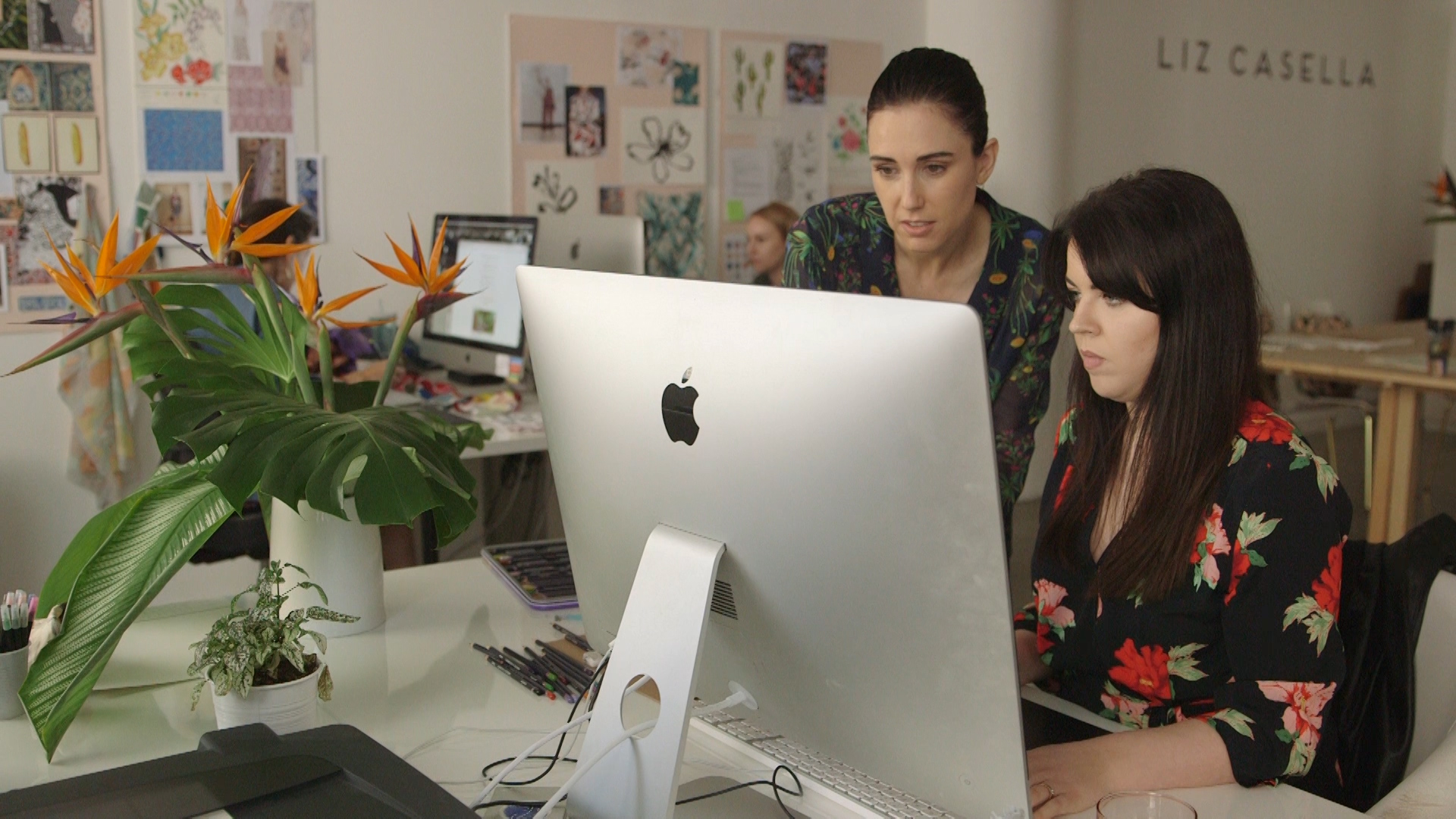 Liz Casella working with an employee in her office.jpg