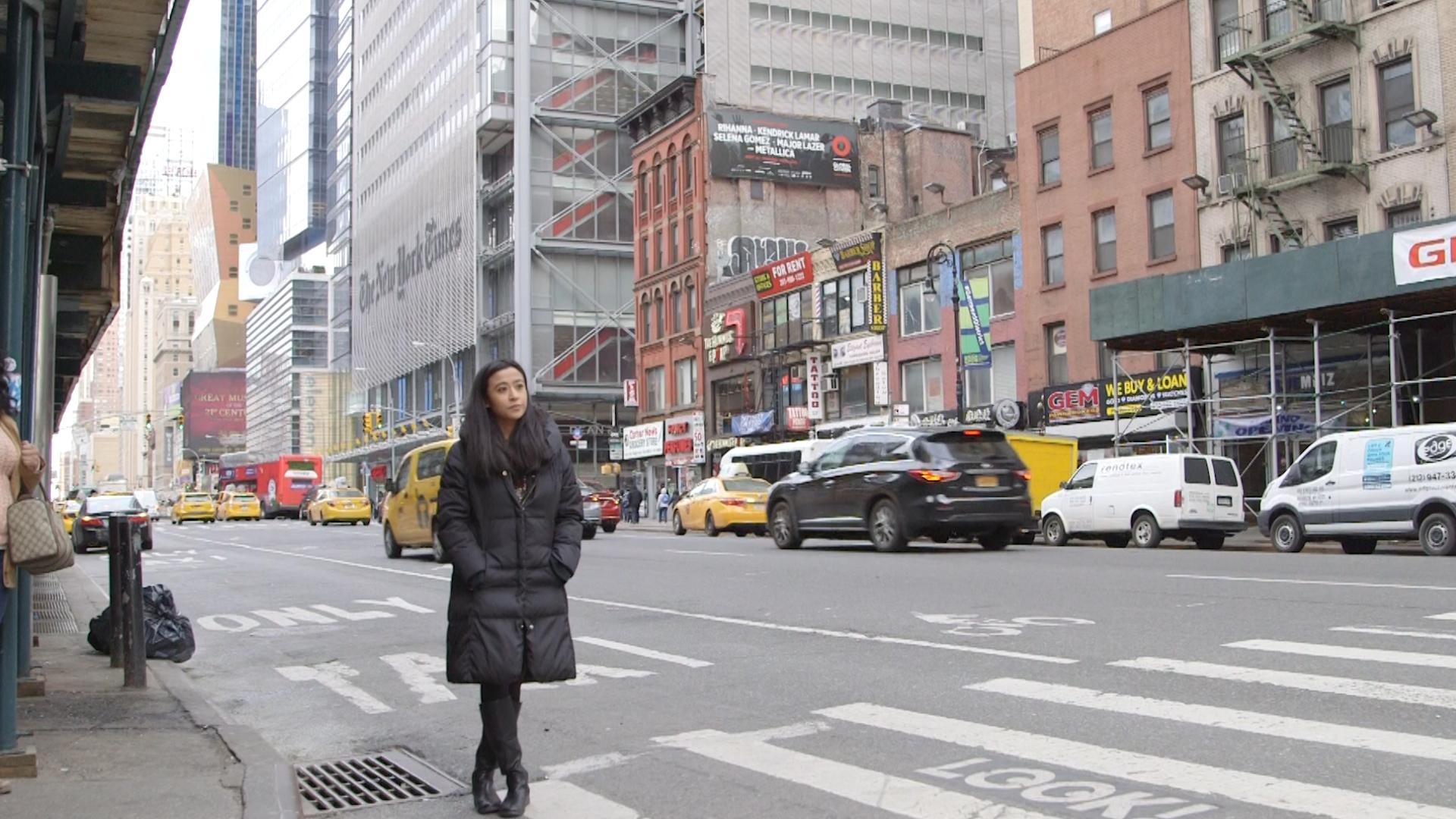 Saya Woolfalk standing on the street in NYC.jpg