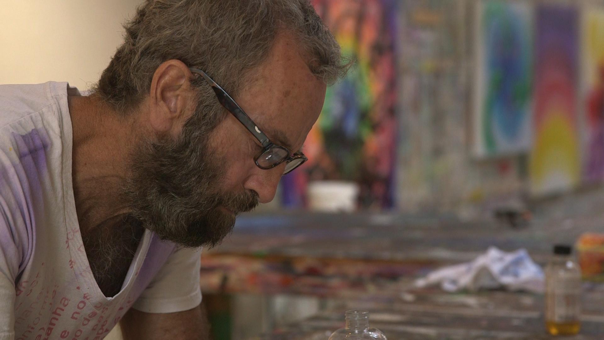Kenny Scharf in the studio working on his art.jpg