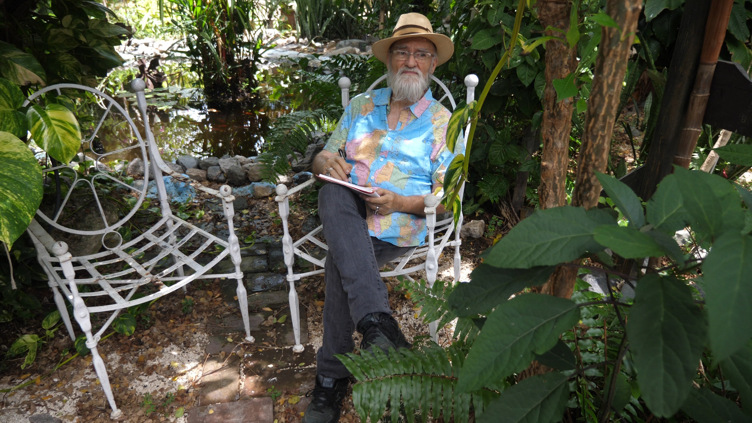 Antonio Martorell chilling in his worldly shirt in the garden.jpg