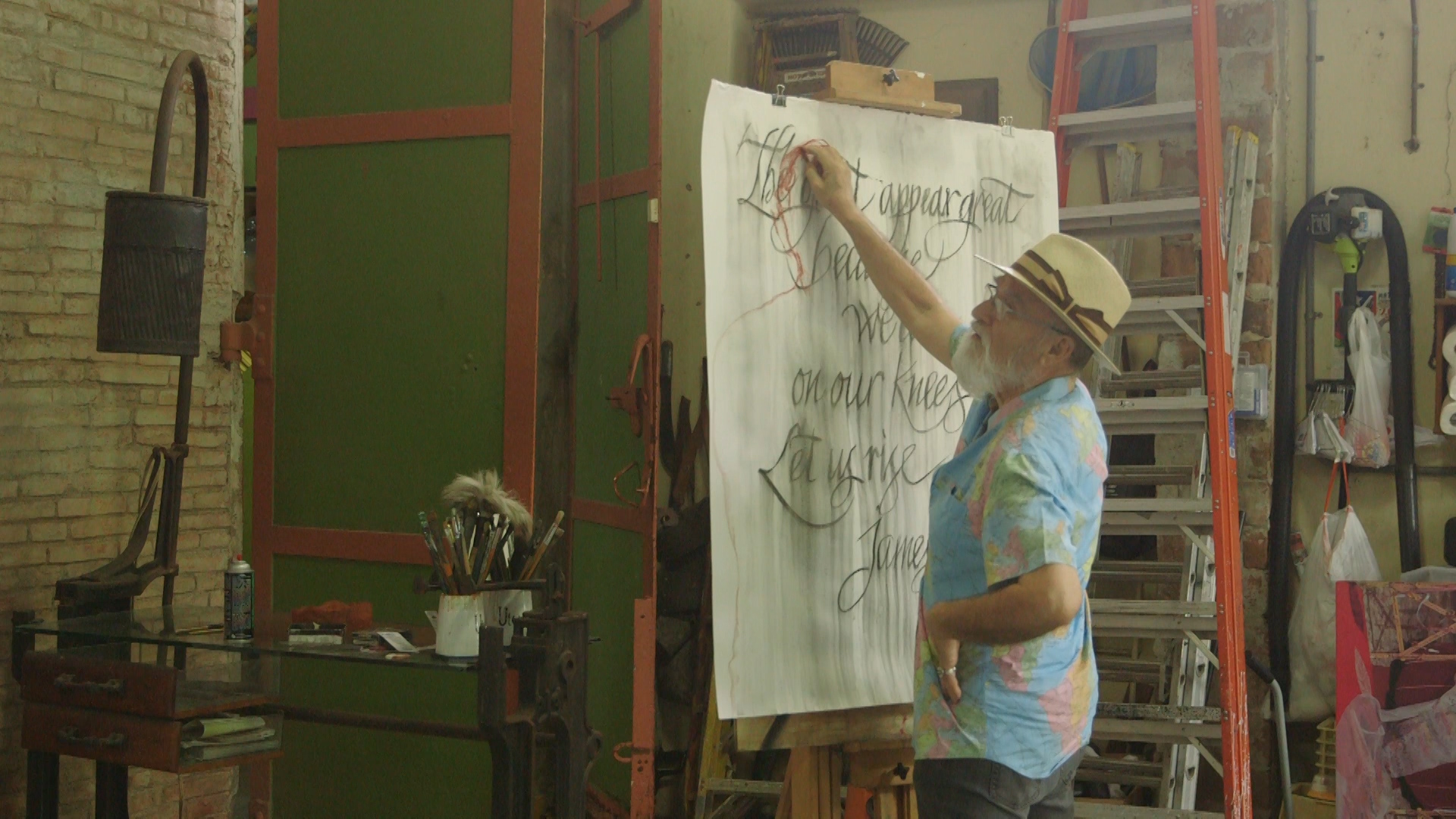 Antonio Martorell drawing a red figure.jpg