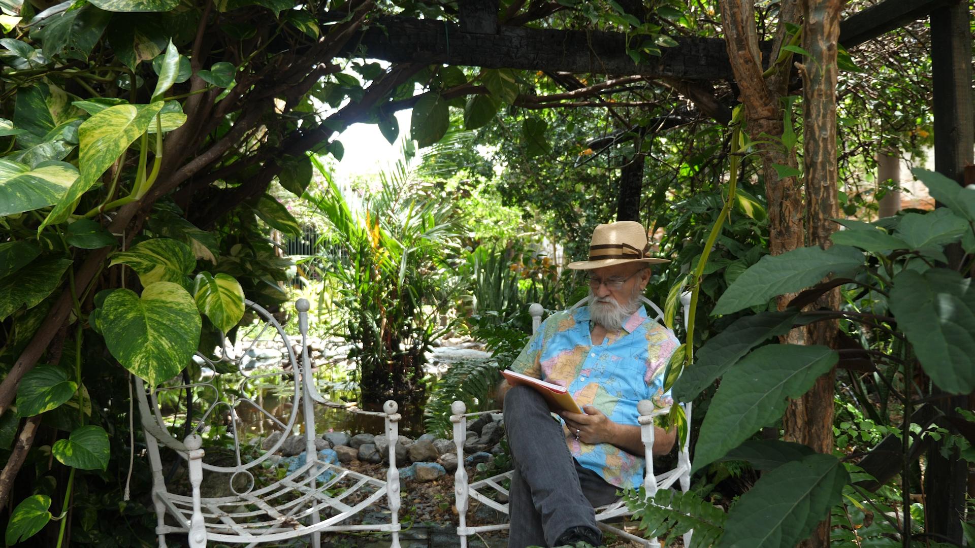 Antonio Martorell reading outdoors.jpg