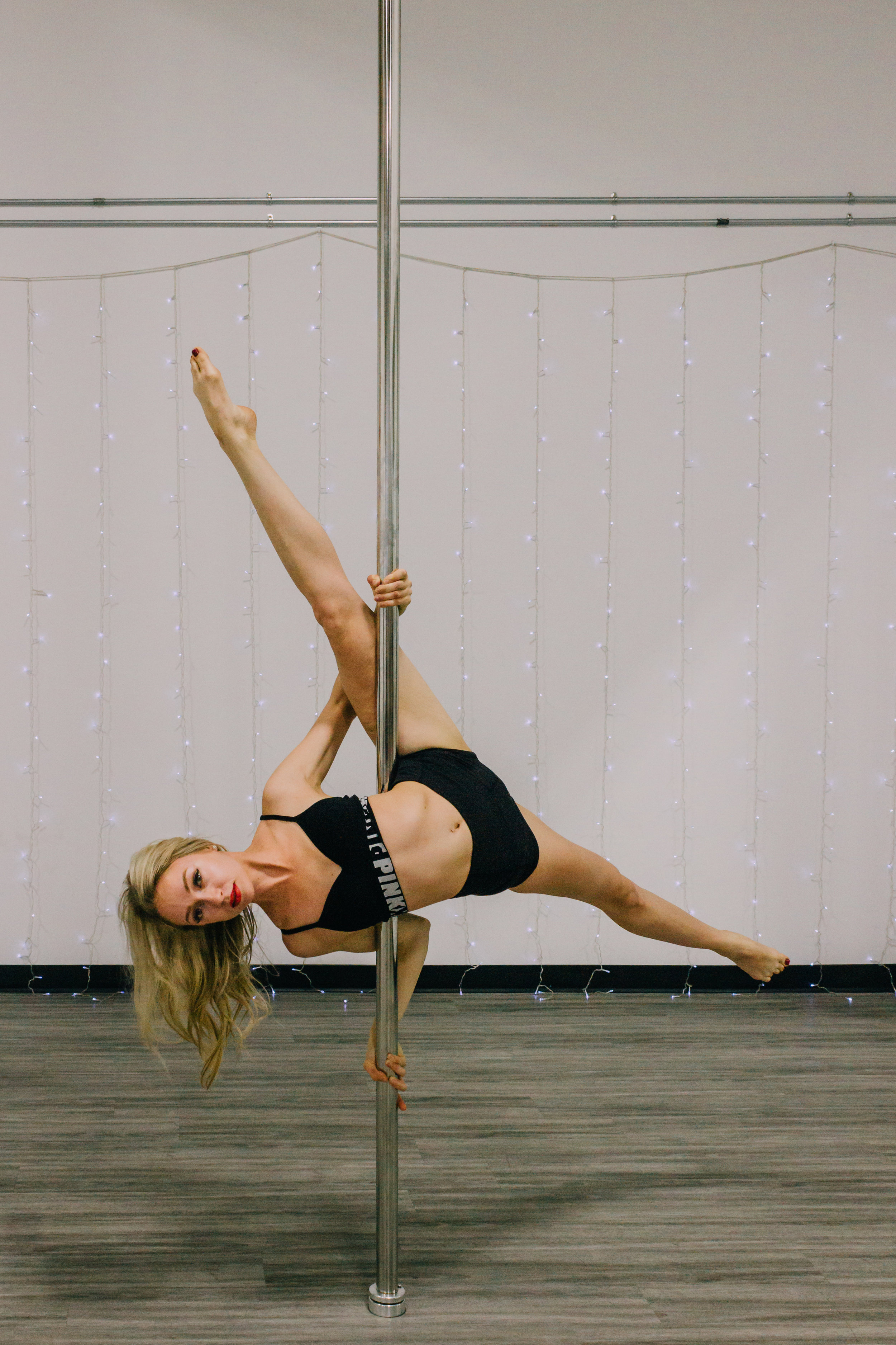 PRE-ADVANCE FUNDAMENTALS OF POLE - PRE-ADVANCE 1The Pre-Advance term is for the student wanting to explore the higher skill set of tricks, techniques & transitions. Within this term, you will be introduced to aerial inverts, climbs, and shoulder mounts.Mandatory Requirements: Strong Chopper & an unassisted leg hang variationNext Step: Pre-Advance 2.PRE-ADVANCE 2Pre-Advance 2 is a continuation of advanced pole. These moves require greater strength & flexibility. Participants must be confident with executing all pre-advanced skills.Mandatory Requirement: Front to back splits, Strong Shoulder MountNext Step: Advanced Pole