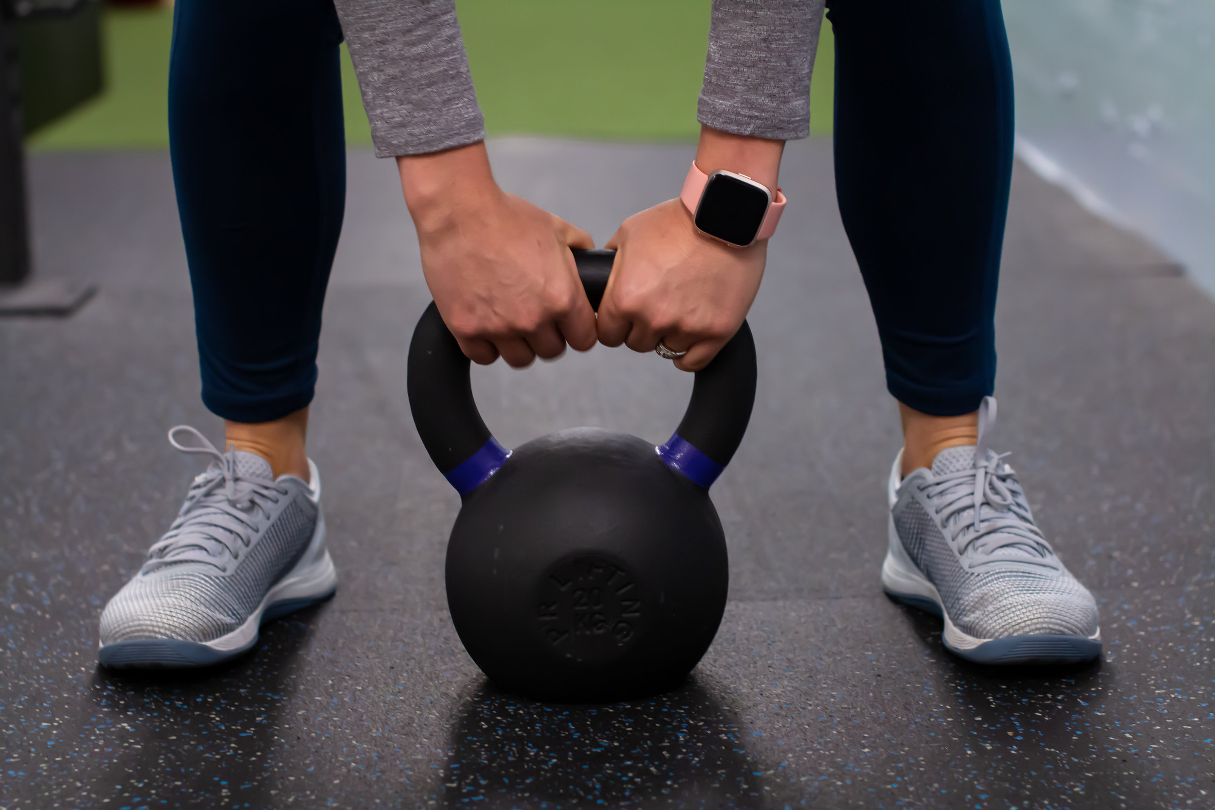 Patient lifting a kettle bell