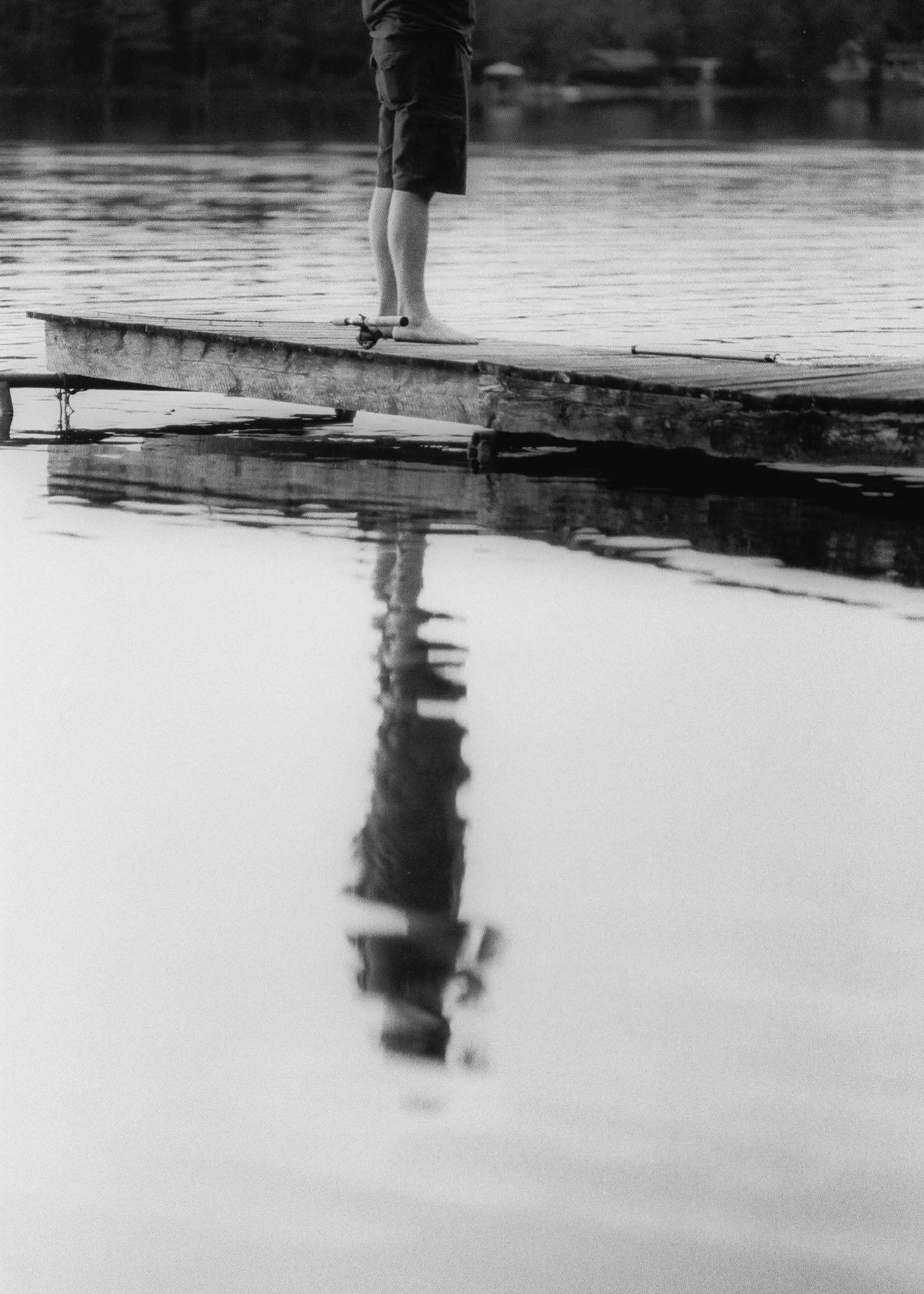 Troy standing on a quay at his friend's cottage. July 2017