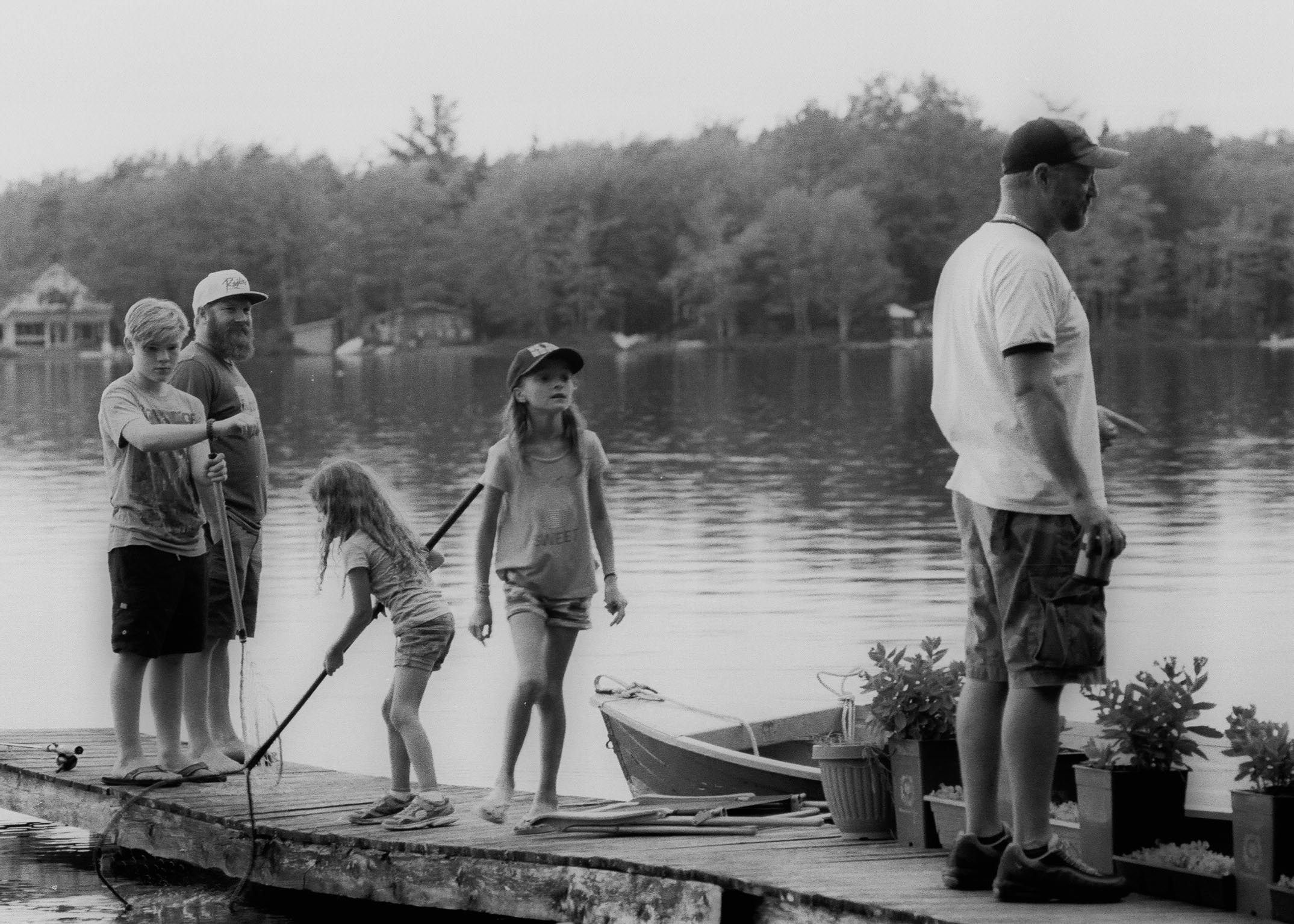 (from left to right) Alstin, Troy and his friend Matt with his daughters at his cottage. July 2017
