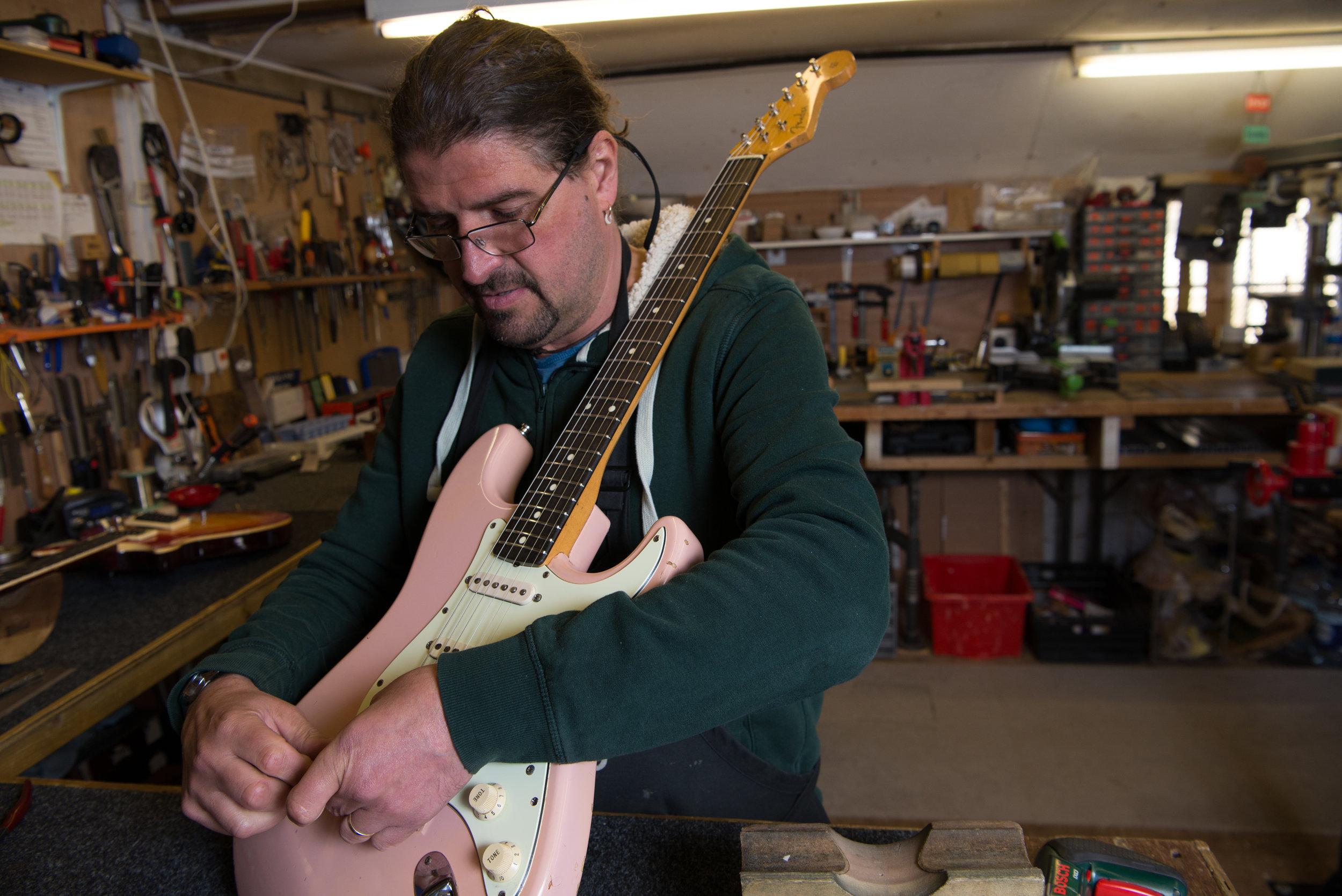 Julyan restringing the guitar. April 2018, Penzance, UK.