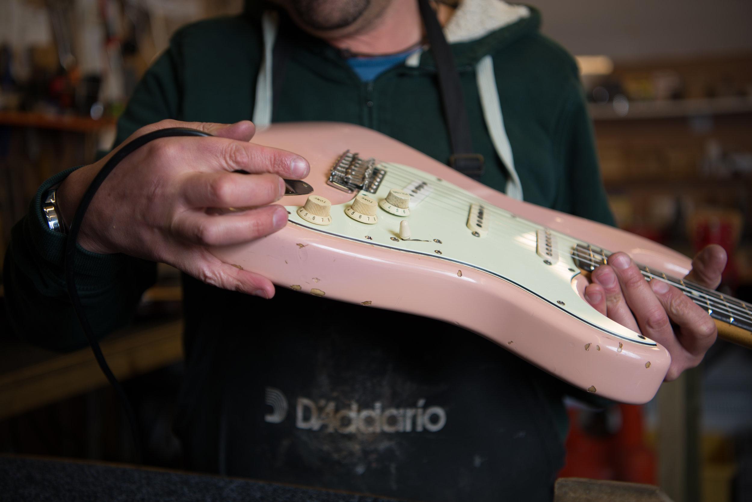 Julyan testing out the guitar. April 2018, Penzance, UK.