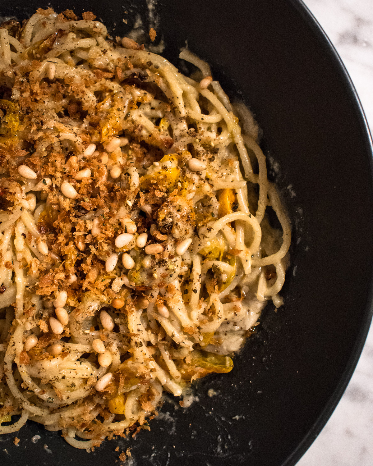 Herbed bread crumbs, toasted pine nuts and za'atar garnish the Roasted Eggplant and Cherry Tomato Pasta.