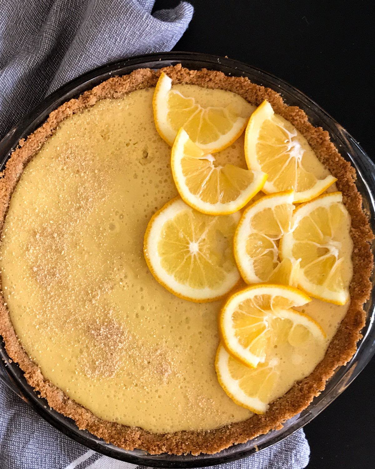 Lemon pie made with fresh squeezed Meyer lemons and cream cheese. Topped with thin lemon slices.