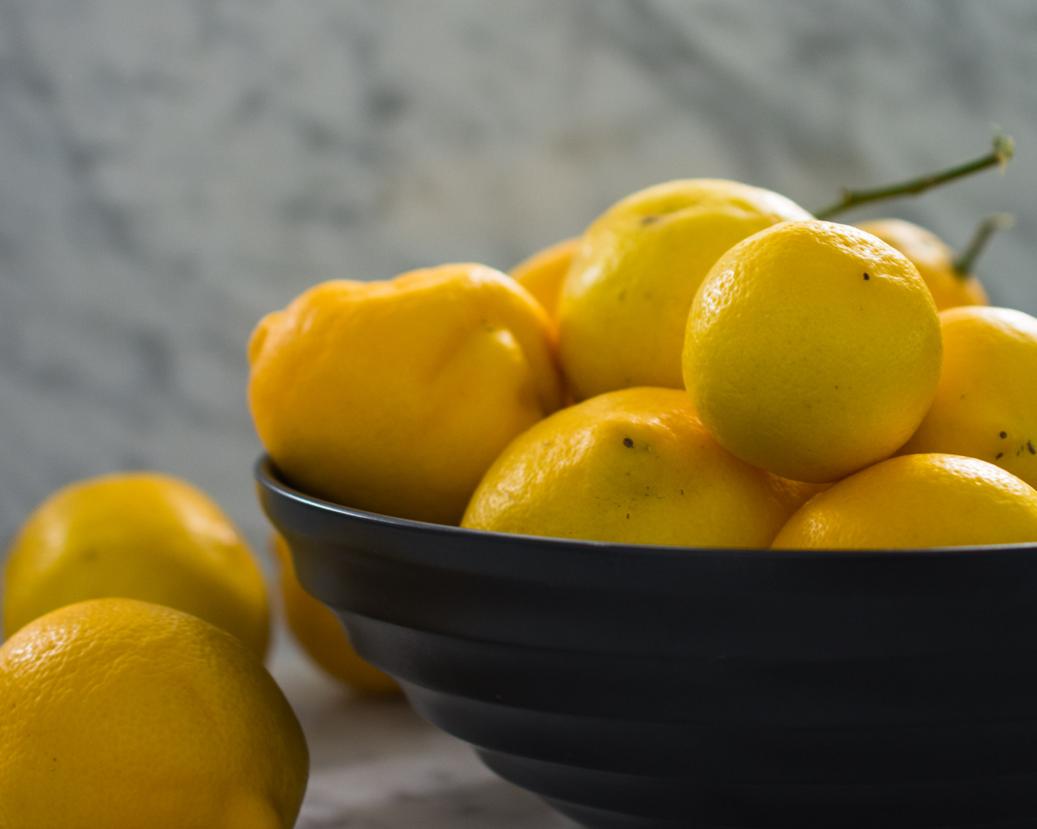 A bowl of fresh Meyer lemons.