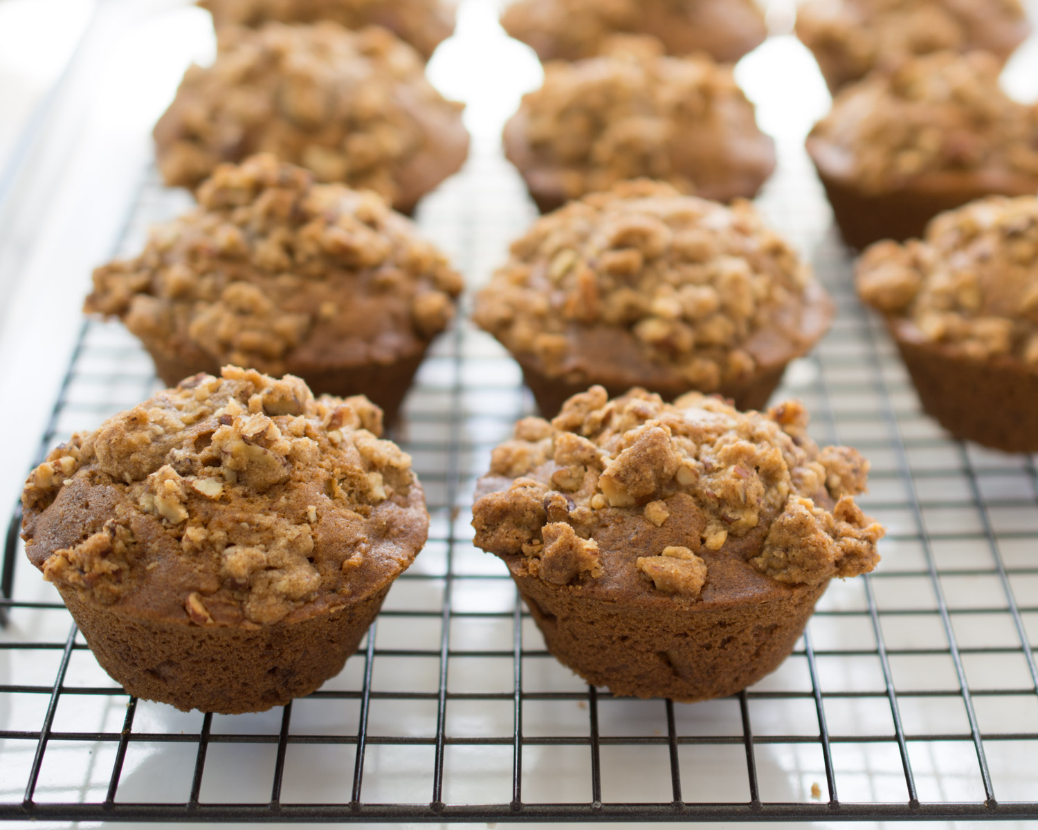 Carrot Cake Muffins cooling on the counter.