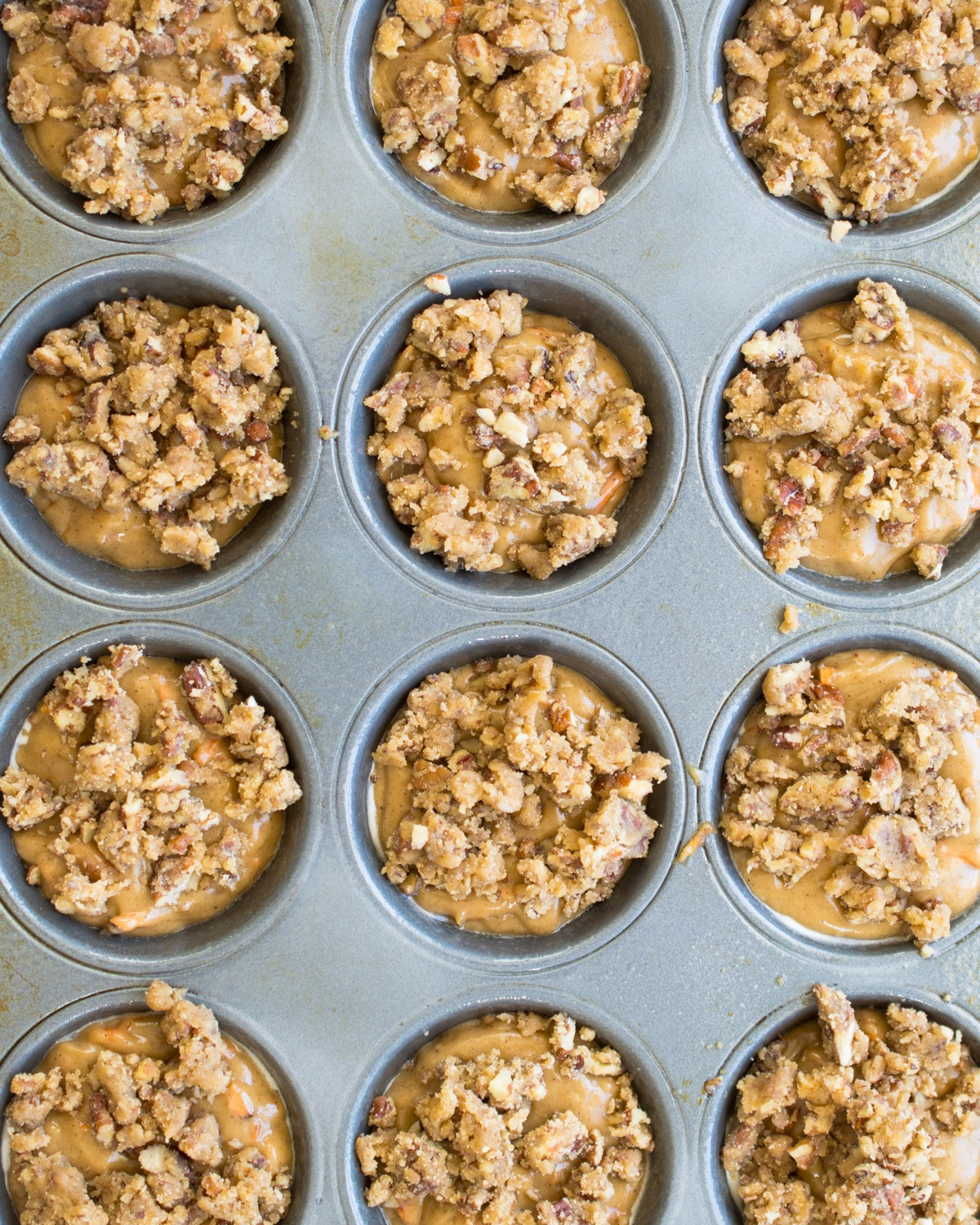 Muffins ready for the oven - just topped with pecan streusel.
