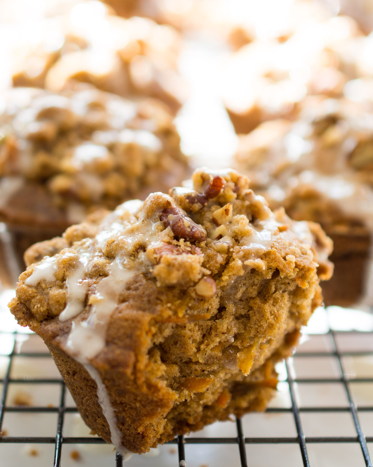 Carrot Cake Muffin topped with pecan streusel and lemon glaze. Ready to eat!